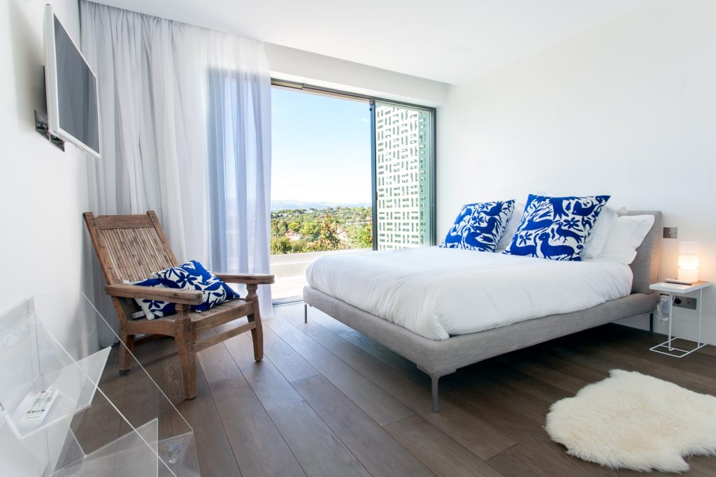 Large Bedroom with Balcony View